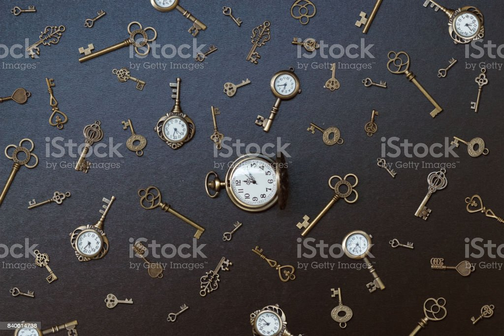 pocket watch and old keys. stock photo