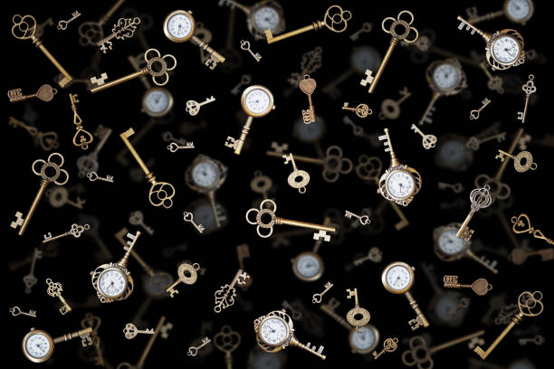 pocket watch and old keys. Vintage Wonderland background. stock photo