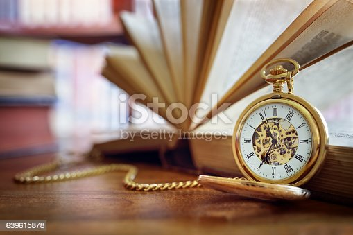 istock Pocket watch in library or study 639615878
