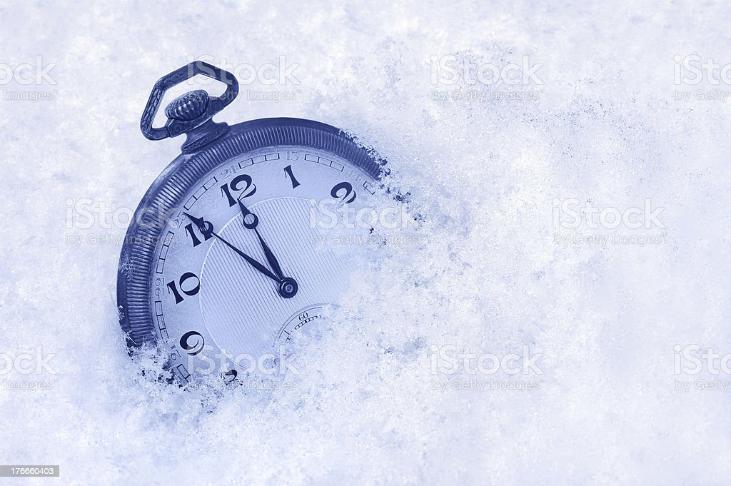 Pocket watch in snow, Happy New Year greeting card royalty-free stock photo