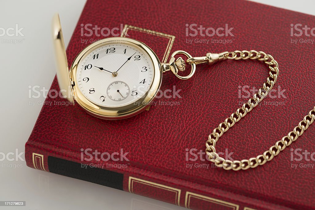 Pocket watch on a red book stock photo