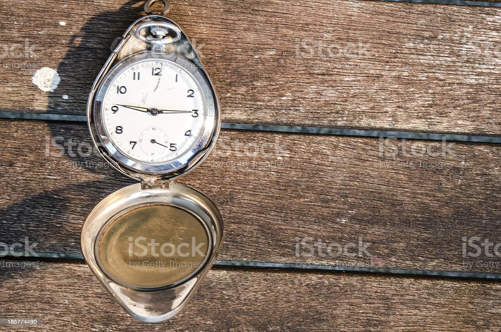 pocket watch on distressed wood royalty-free stock photo