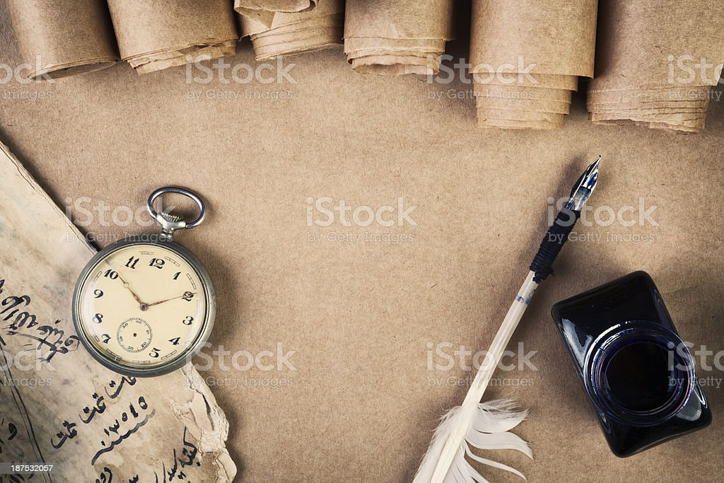 Pocket watch on grunge paper with quill and ink stock photo