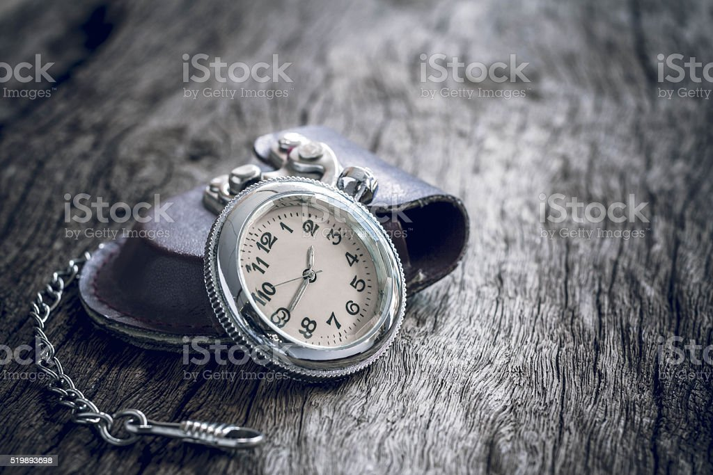 pocket watch on old wooden background. stock photo