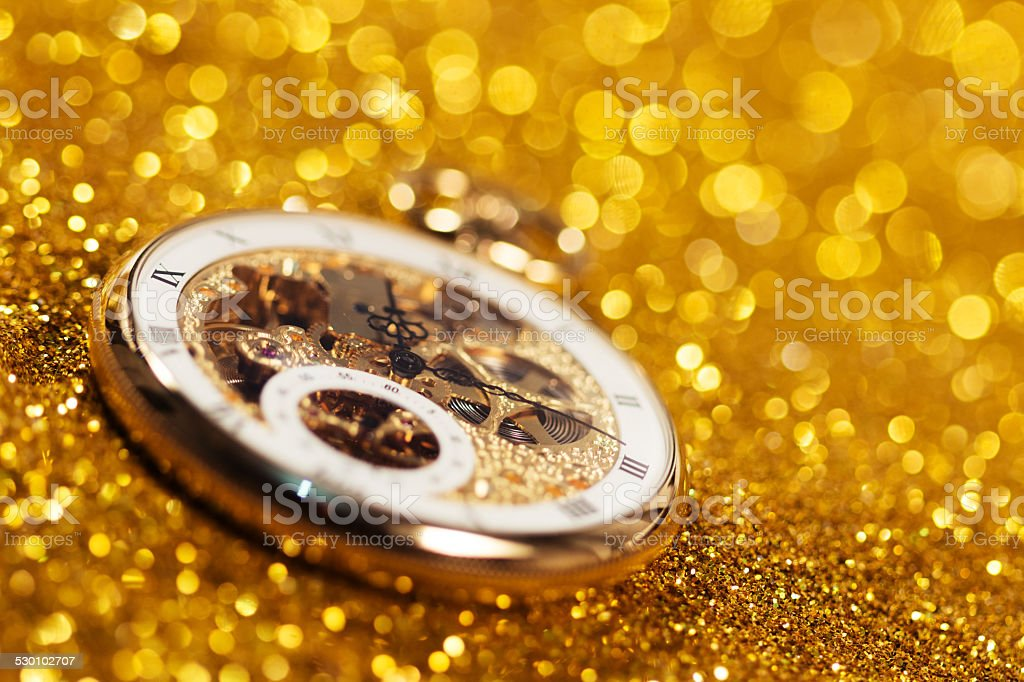 pocket watch on the gold sand background stock photo
