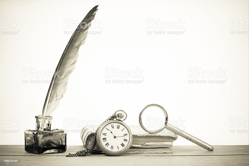 Pocket watch, quill, inkwell, book, magnifying glass royalty-free stock photo