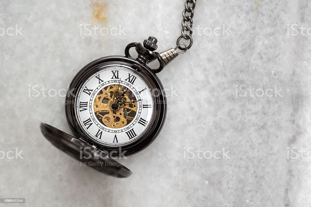 Pocket watch with  chain on marble. photo libre de droits