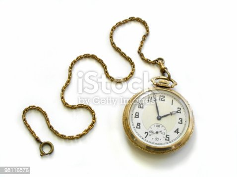 vintage pocket watch on a chain of bronze color close-up on a black background.
