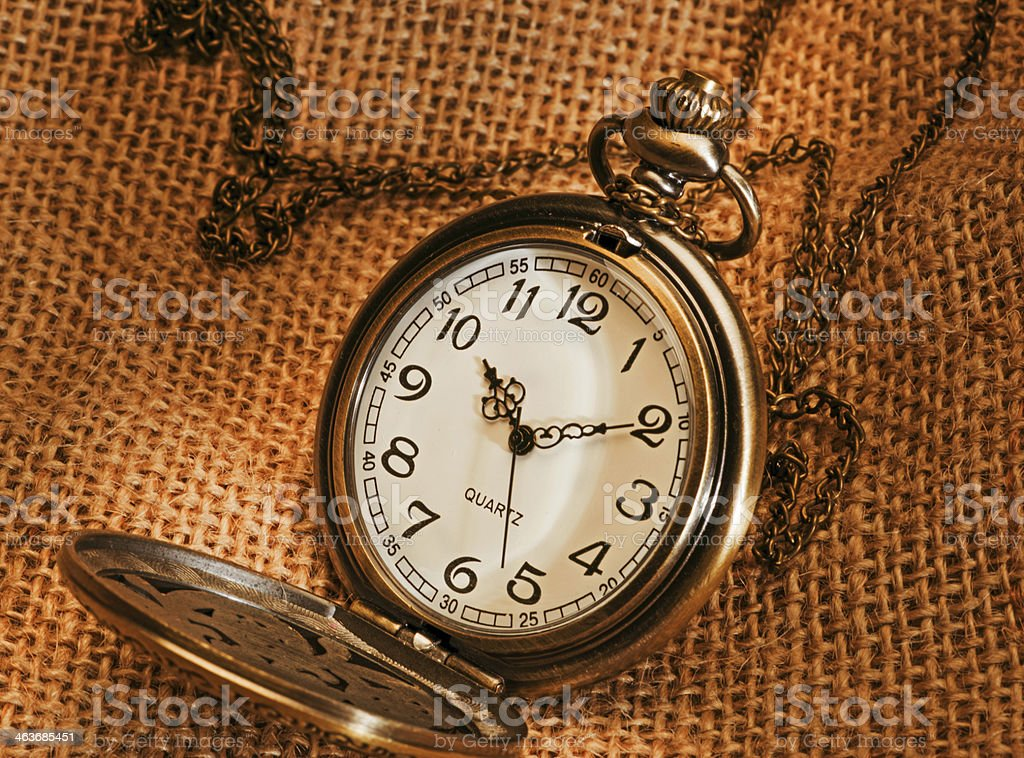 pocket watch with gunny royalty-free stock photo