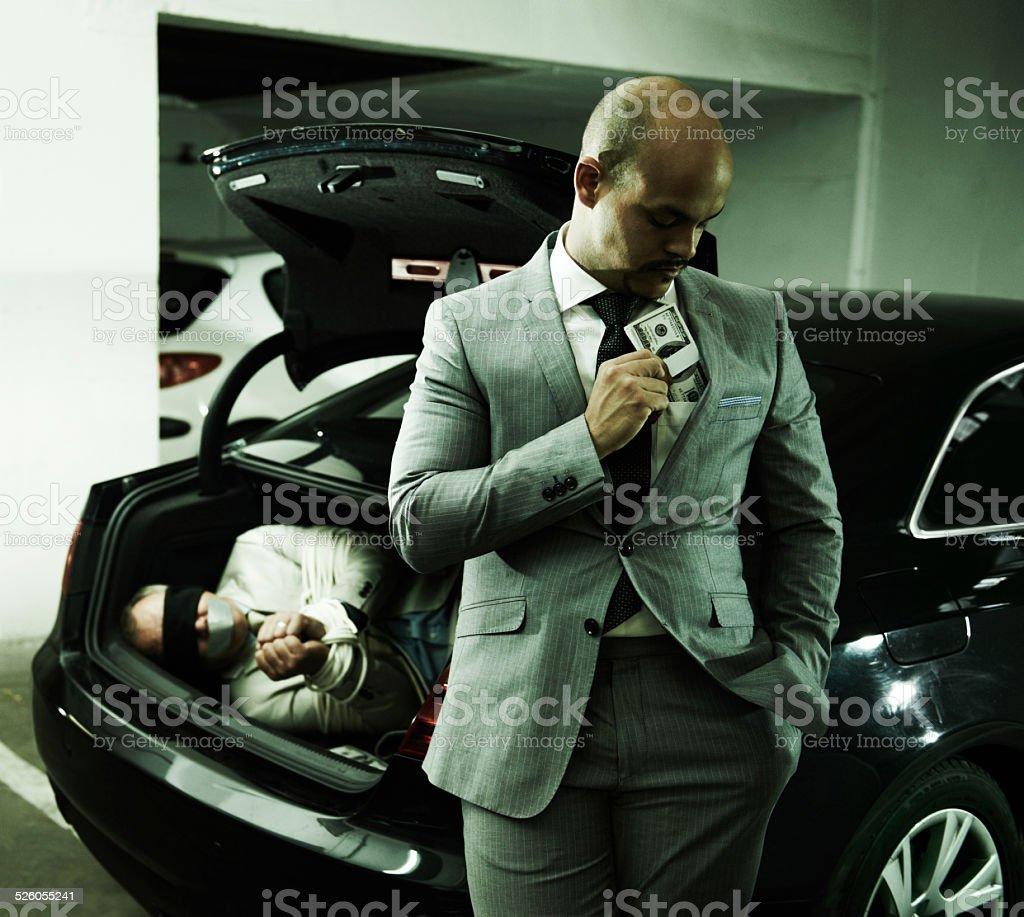 Pocketing his cash stock photo