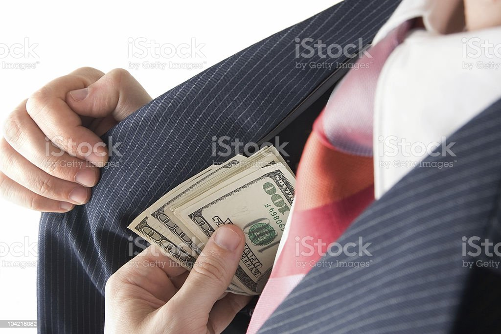 Pocketing Some Cash royalty-free stock photo
