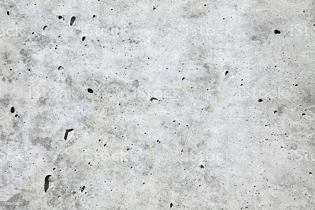 Pockmarked blotchy gray concrete surface royalty-free stock photo