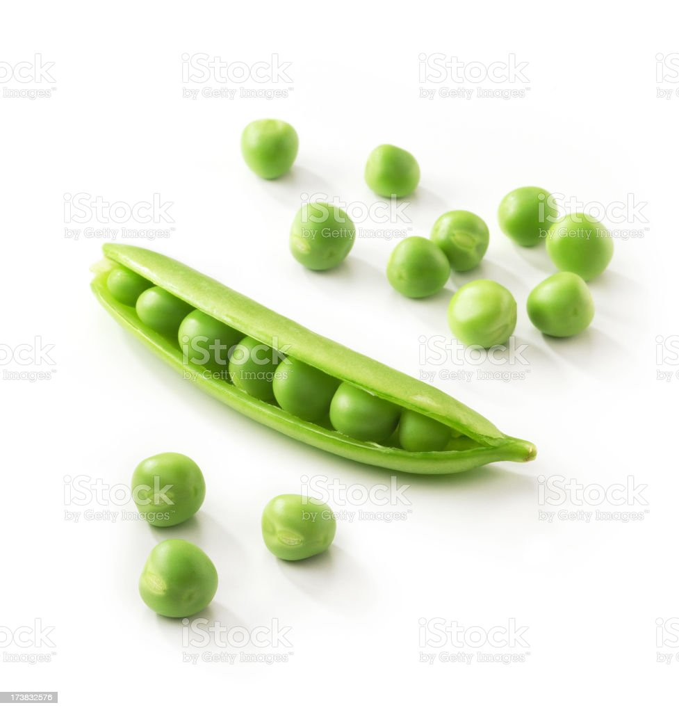 A pod full of green peas on a white background stock photo