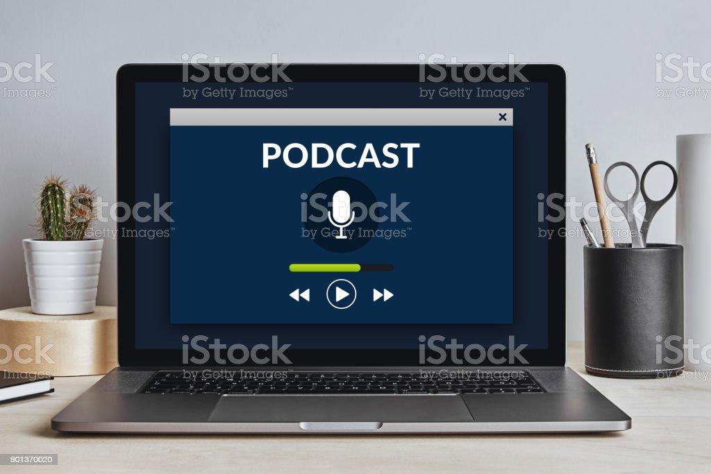 Podcast concept on laptop screen on modern desk stock photo