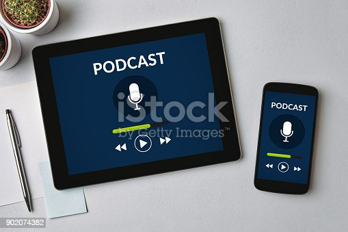 istock Podcast concept on tablet and smartphone screen 902074382