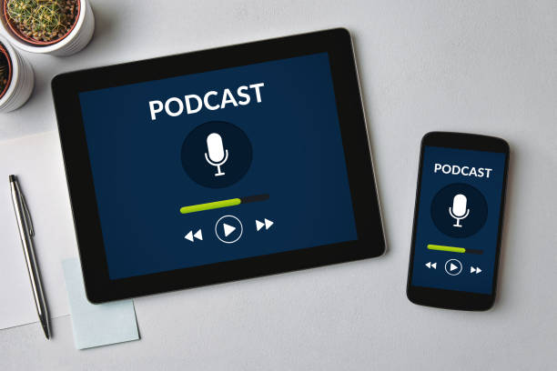 Podcast concept on tablet and smartphone screen stock photo