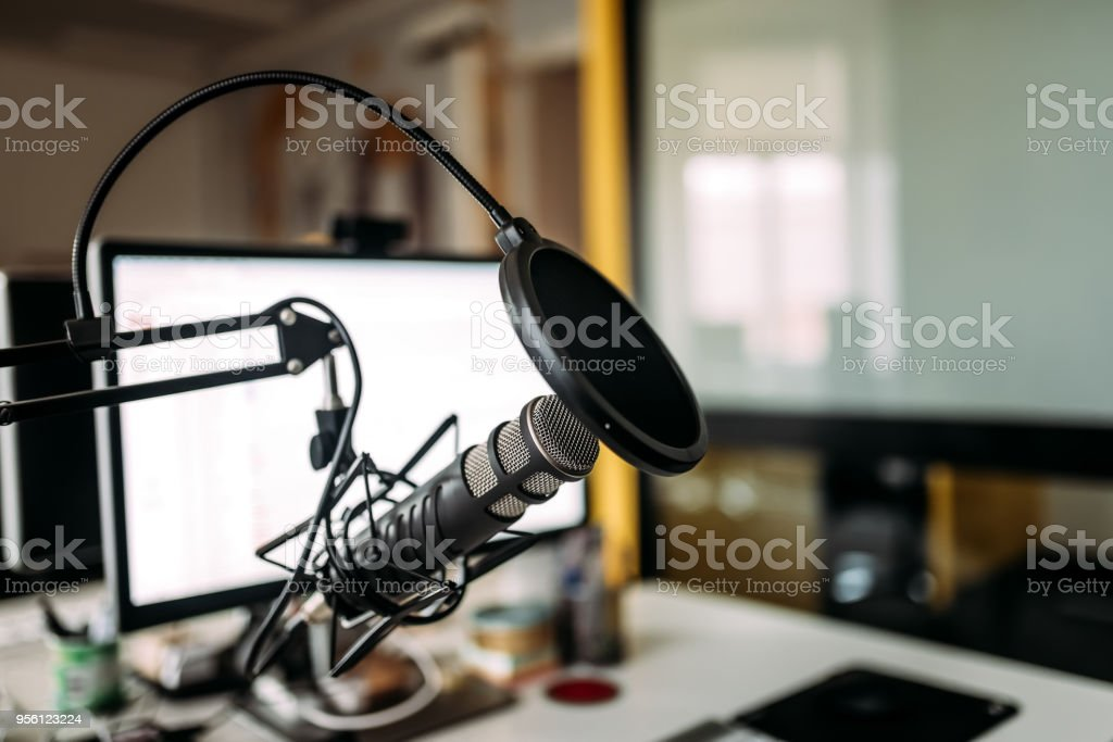 Podcast studio: microphone and computer. stock photo