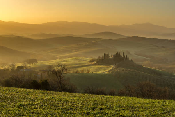 Podere Belvedere villa at sunrise, Orcia Valley, Italy stock photo