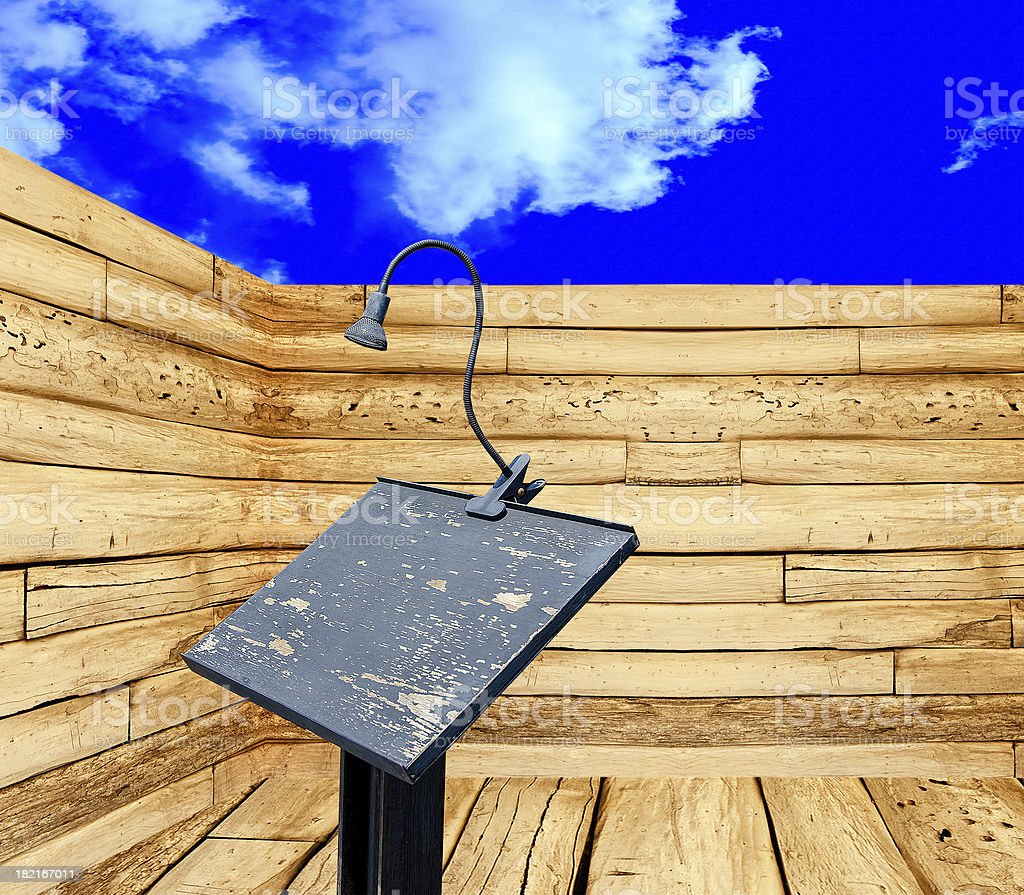 Podium and microphone in perspective view on blue sky background royalty-free stock photo