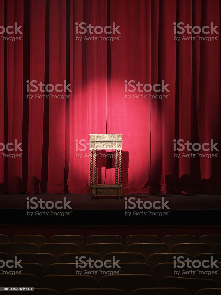 Podium on stage illuminated by spotlight royalty-free stock photo