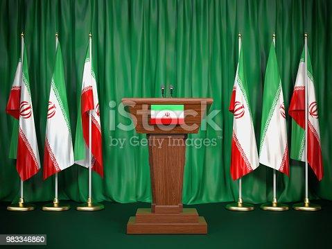 istock Podium speaker tribune with Iran flags. Briefing of president of Iran. Politics concept. 983346860