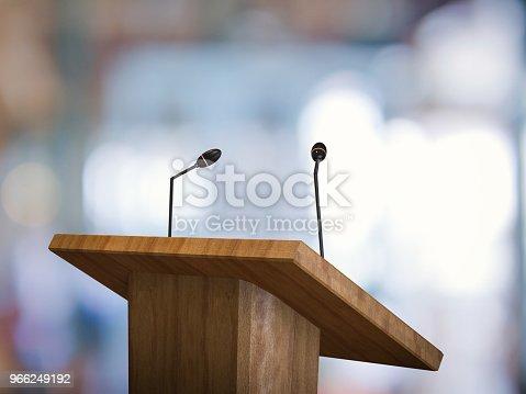 istock podium with microphone 966249192