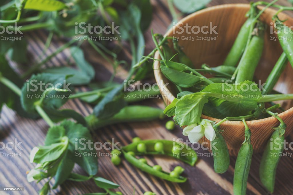Pods of green peas and pea on dark wooden surface royalty-free stock photo