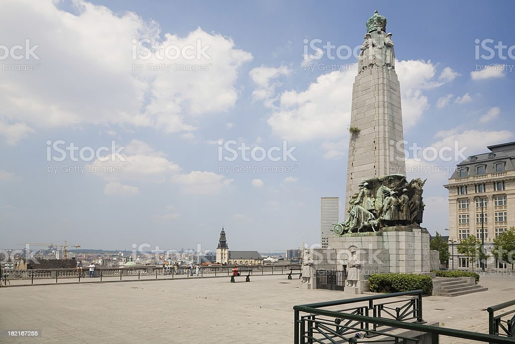 Poelaert square in Brussels Overview of the Poelaert square in Brussels with the monument to the glory of Belgian Infantry in World War I and II. Founded in 1935.In the background: skyline of Brussels city. Architecture Stock Photo