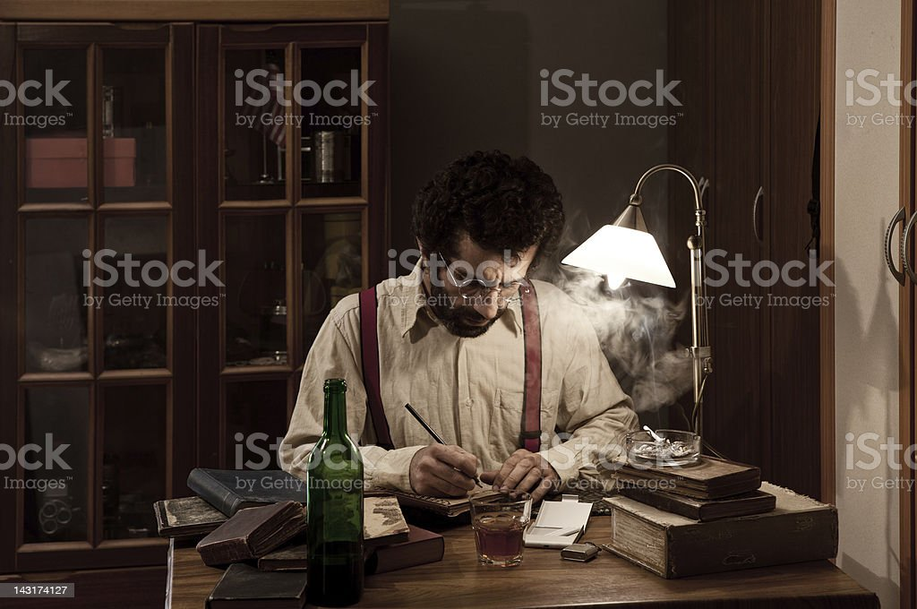 Poet writing on table in the dark stock photo