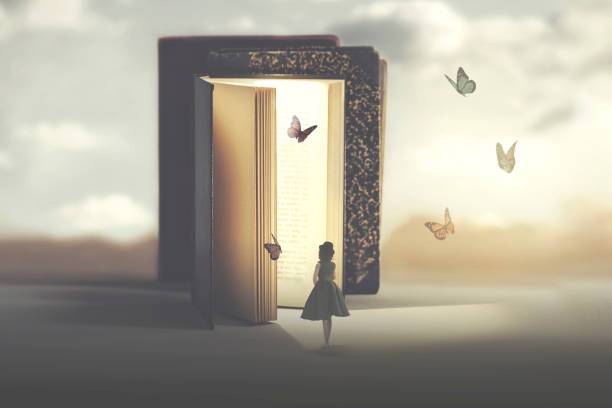 poetic encounter between a woman and butterflies coming out of a book stock photo