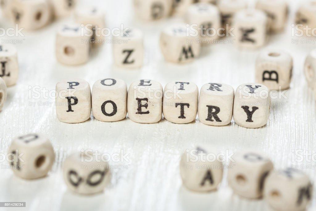 Poetry word written on wood block. stock photo