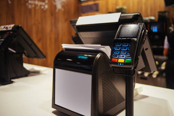 Poin of sell terminal with touchless technology and cashbox on background Poin of sell terminal with touchless technology and cashbox on background cash register stock pictures, royalty-free photos & images