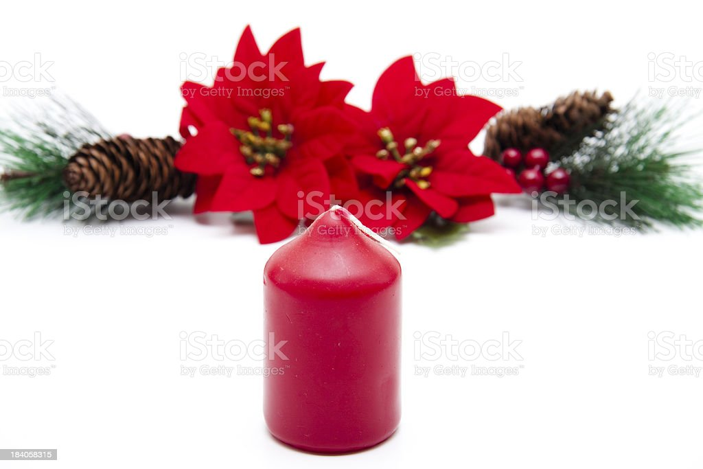 Poinsettia with red candle royalty-free stock photo