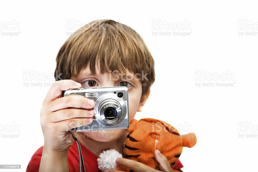 Point and shoot camera in childs hands royalty-free stock photo