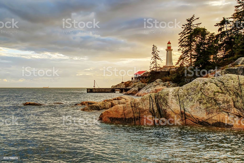 Point Atkinson Lighthouse at sunset after thunderstorm, West Vancouver, BC stock photo