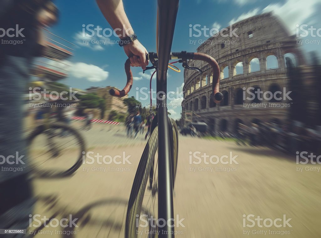 Point of view POV bicycle to the Coliseum of Rome stock photo