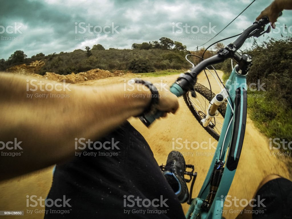 Point of view POV mountain bike stunt riding stock photo