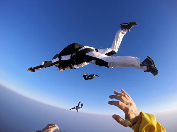 Point of view of a skydiver jumping from the plane. stock photo
