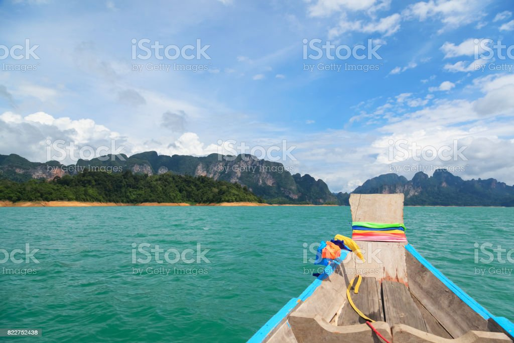 Point of view of Cheow Lan lake from long tail boat at Khao Sok National Park stock photo