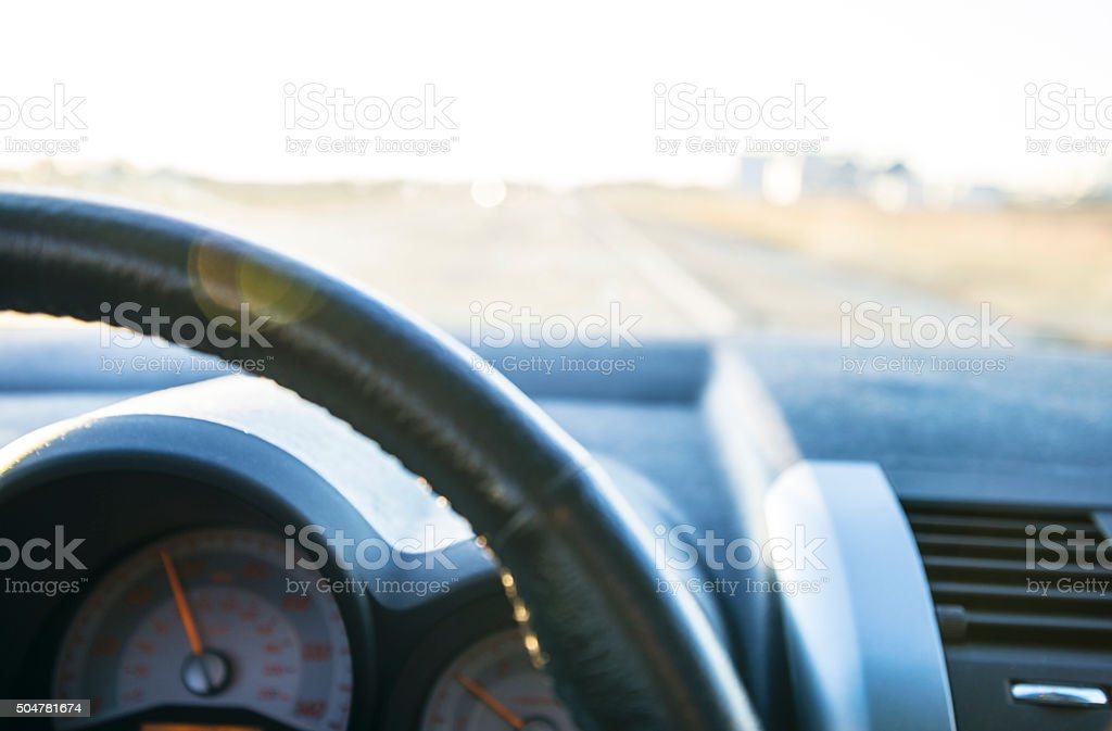 Point of View of Driving a Car from Behind Wheel stock photo