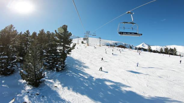 POV point of view. Open air ski lifts in Bansko, Bulgaria stock photo