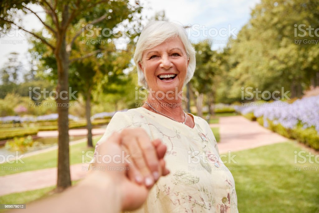 Point Of View Shot Of Senior Couple Walking In Park Together стоковое фото
