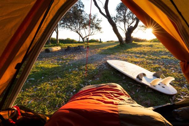 Point of view sunrise from inside hiking tent stock photo