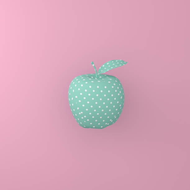 Point pattern white on green apple on pink background. minimal idea food concept. An idea creative to produce work within an advertising marketing communications or artwork design. stock photo