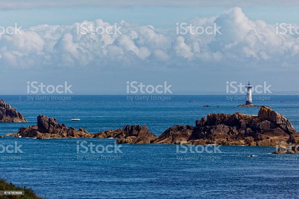 Pointe du Groin and Lighthouse of Pierre-de-Herpin stock photo