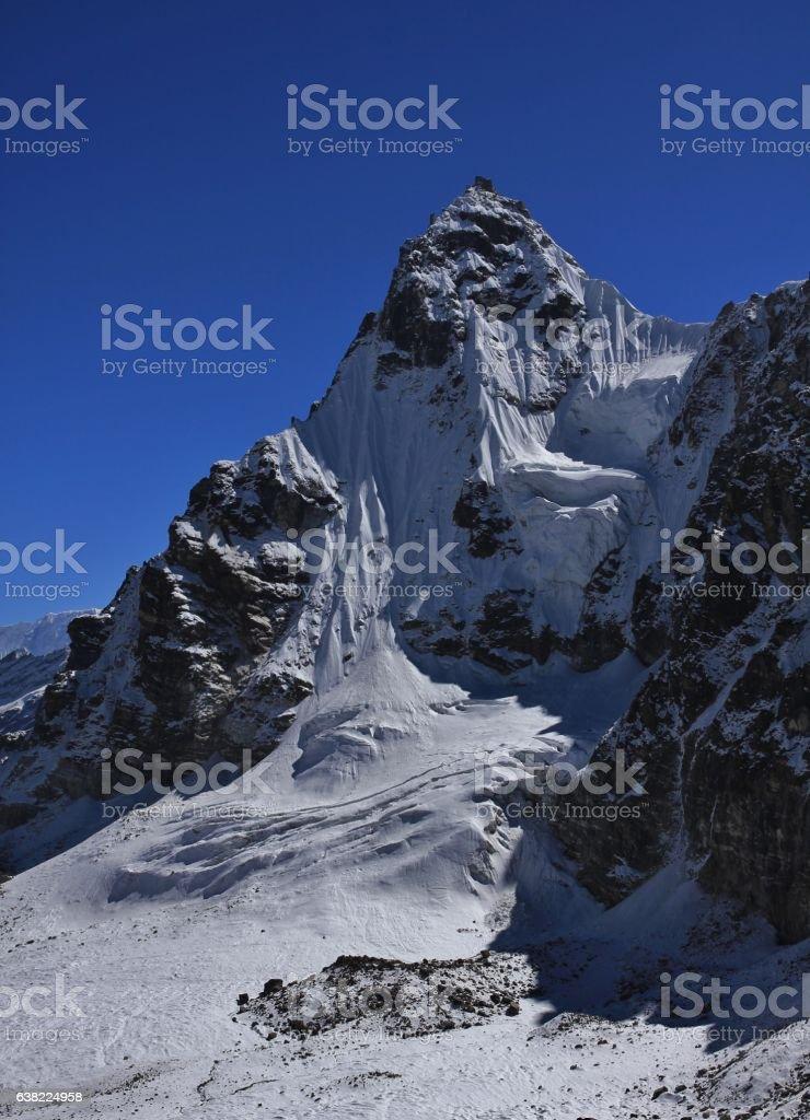Pointed mountain next to the Renjo La mountain pass stock photo
