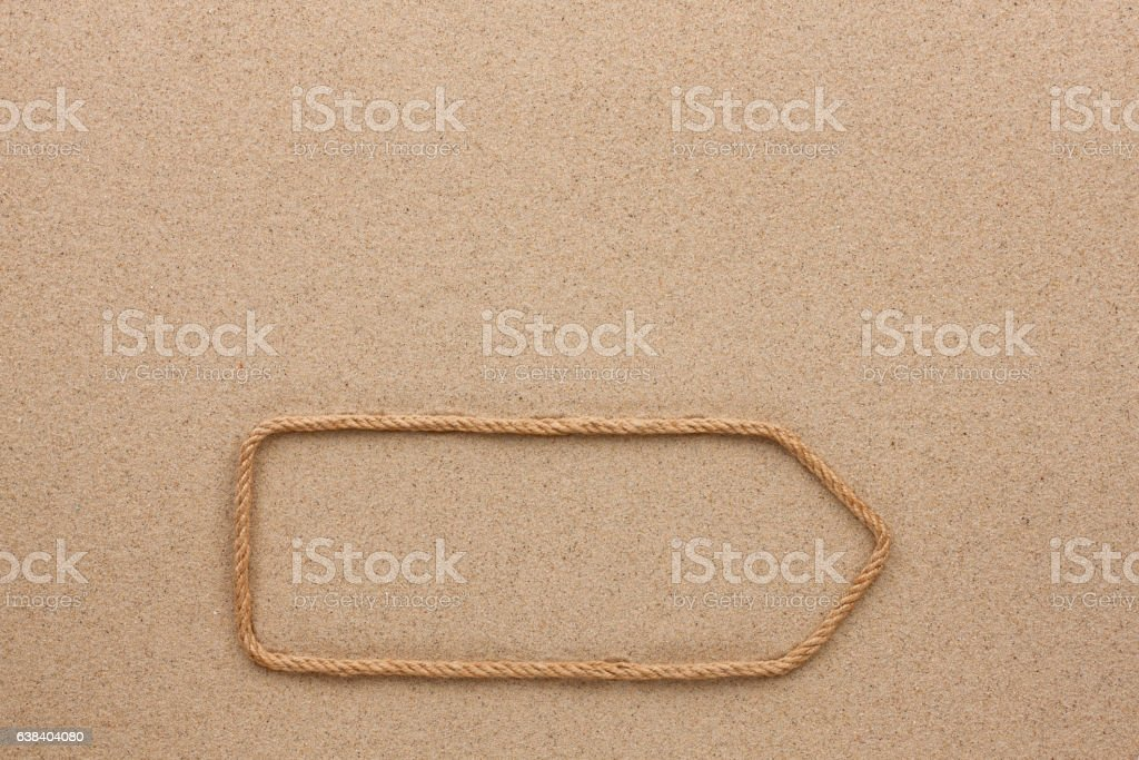 Pointer faite de corde sur le sable  - Photo