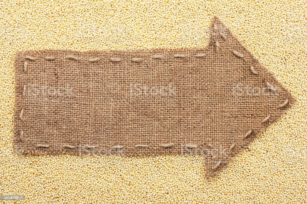Pointer of burlap with place for your text, lying millet stock photo