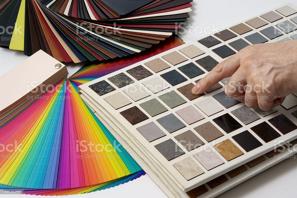 Pointing a color samples and decorating samples on white background royalty-free stock photo