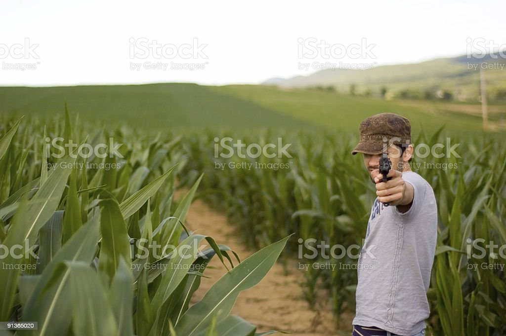 Pointing a gun 3 stock photo